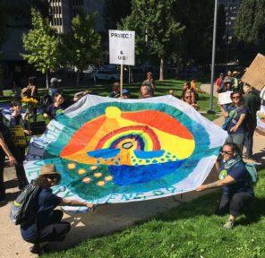 San Francisco Climate March - Mural and Parachutes at City Hall